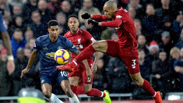 Fabinho of Liverpool against Manchester United's Marcus Rashford. Photograph: Peter Powell/EPA