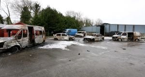 TENSIONS HIGH: Five out of six vehicles which were burnt out outside a house in Strokestown, Co Roscommon, amid a violent raid by masked men after an eviction at the house last week. Photograph: Brian Farrell