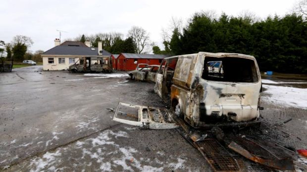 Burnt-out vans and cars in the yard of the house which was the scene of an eviction in Strokestown last week. Photograph: Brian Farrell
