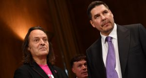 T-Mobile chief executive John Legere (L) and Sprint executive chairman Marcelo Claure. Photograph: MANDEL NGAN/Getty Images