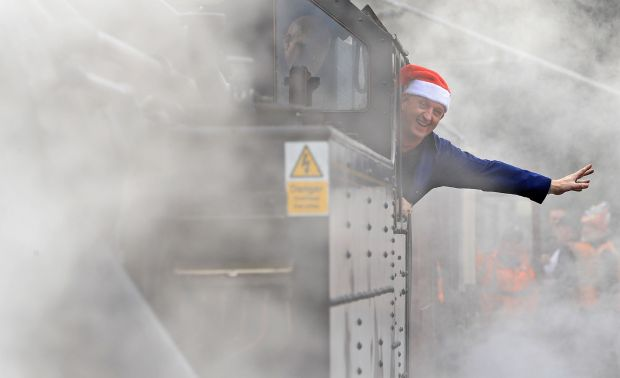 Steam train driver Robert Jolley waves as the Santa Express departs from Connolly Station Photograph: Donall Farmer/The Irish Times