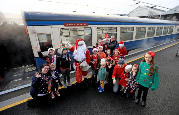 Santa and the passengers Connolly station before the first Santa Express of the season on Saturday, December 1st Photograph: Donall Farmer/The Irish Times
