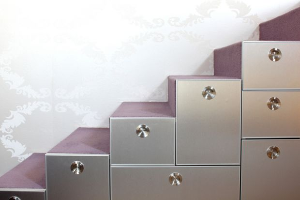 Stairs with carpet and drawers in the modern home