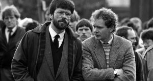 Gerry Adams and Martin McGuinness (right) at the funeral of Patrick Kelly. Photograph:  PA Wire