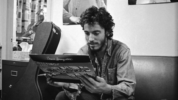 Bruce Springsteen in 1972, getting his first glimpse of his first album Greetings from Asbury Park, NJ
