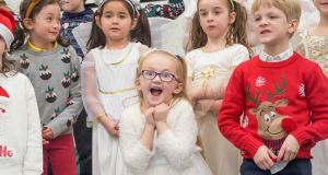 A STAR IS BORN: An excited Arabella Daly (6), from Gaelscoil Osrai, Kilkenny, spots her parents in the audience during the school Nativity play. Photograph: Pat Moore