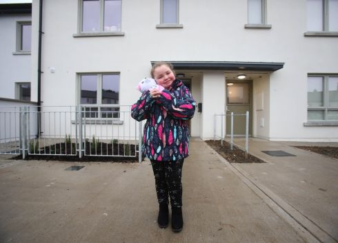 At the launch of the Avondale Heights social housing development, in Rathdrum, Co Wicklow, is Ella Smyth (7), outside her new home. The social housing development consists of 20 state-of-the-art homes constructed on behalf of Wicklow County Council, and are available to move into in time for Christmas.
