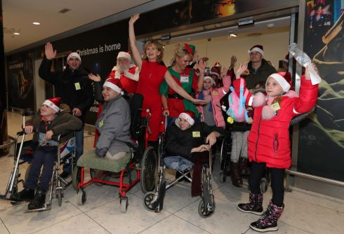 CHRISTMAS CHEER: Adi Roche with part of 40-strong group of children from the Chernobyl region of Ukraine, who flew into Dublin Airport to spend the festive season with Irish host families. The children, who have varying levels of disability and illness, will stay for more than two weeks of rest and recuperation thanks to Ms Roche's Chernobyl Children International charity. Photograph: Colin Keegan/Collins Dublin