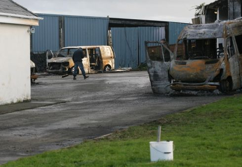 EVICTION AFTERMATH: A clean-up begins with the help of friends and neighbours after several vehicles were burned and property was damaged after violence related to an eviction at a house near Strokestown in Co Roscommon at the weekend. Photograph: Brian Farrell