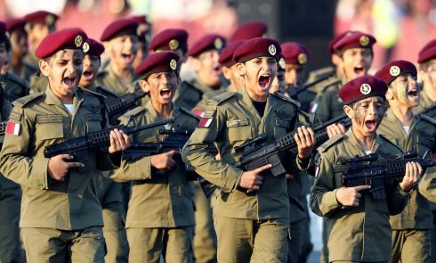 SHOUT OUT: Qatari youths participate in a military parade in Doha marking celebrations of Qatar's national day. Photograph: Karim Jaafar/AFP/Getty Images