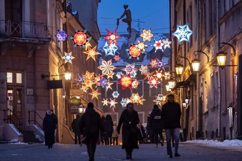 STARRY NIGHT: Christmas lighting and decorations set up over a street in Lublin, Poland. Photograph: Wojciech Pacewicz/EPA