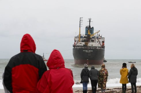 KEEPING WATCH: Locals watch as the coast guard attempts to refloat the stricken cargo ship Kuzma Minin, grounded off Falmouth, England. The Russian vessel ran aground off Gyllyngvase Beach, along England's Cornish coast, and was reported to have no cargo. Photograph: Matt Cardy/Getty Images