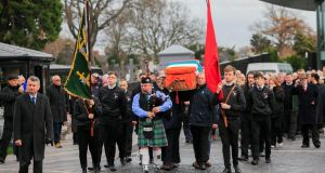 The remains of Workers' Party activist Seán Garland arrive for his funeral in Glasnevin Cemetery, Dublin. Photograph: Gareth Chaney/Collins