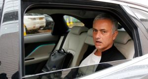 Jose Mourinho is driven away from his hotel  after being sacked by Manchester United . Photograph: Phil Noble/Reuters