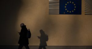 A man walks past the headquarters of the European Commission in Brussels. The compromised material provides insight into Europe's struggle to understand the political turmoil engulfing three continents. Photograph: Dan Kitwood/Getty Images