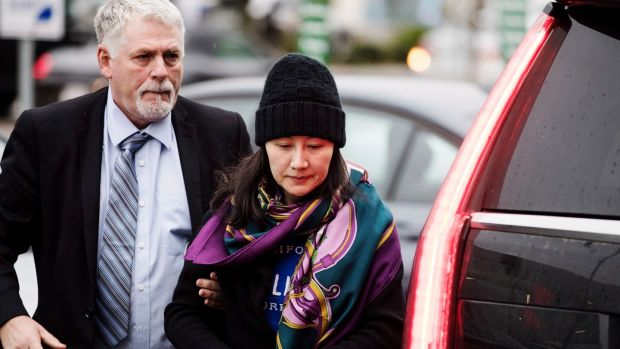 Huawei chief financial officer Meng Wanzhou arrives at a parole office with a security guard in Vancouver, Canada, last week. Photograph: The Canadian Press