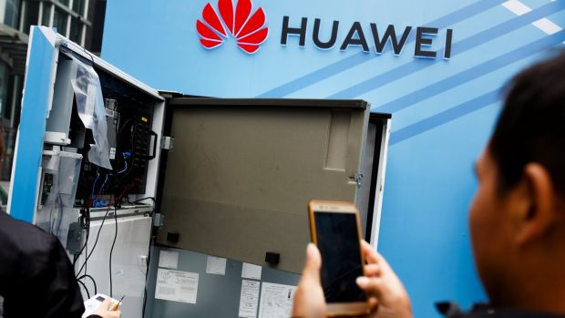 Huawei workers have been accused of bribing government officials to win business in Africa, copying an US competitor's source code and even stealing the fingertip of a robot in a T-Mobile lab. Photograph: Reuters