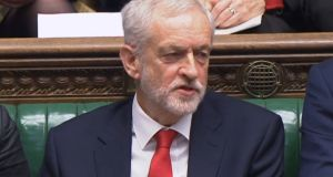British Labour leader Jeremy Corbyn talks under his breath after British prime minister Theresa May  speaks. Photograph: House of Commons/PA Wire