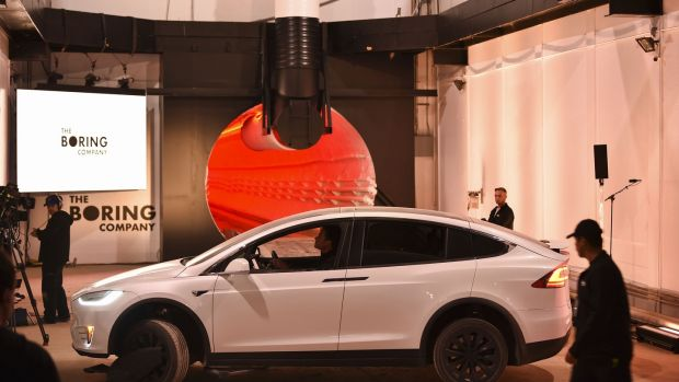 A modified Tesla Model X prepares to enter the tunnel at the unveiling event. Photograph: Bloomberg