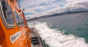 "The RNLI's ""Anna Livia"", stationed at Dún Laoghaire. As part of its annual ceremony  the station's two lifeboats will drop wreaths into the sea in view of the public gathered at the end of the east pier."