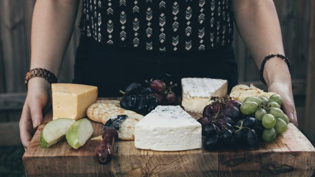 Include a soft cheese, a blue cheese and a hard cheese in your cheese board. Photograph: Getty Images