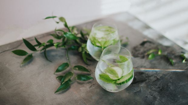Create a gin station with gin, tonics and garnishes, and invite guests to serve themselves