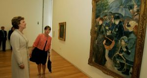 Former president Mary McAleese   at the Hugh Lane Gallery in 2008, looking at Renoir's Les Parapluies (The Umbrellas), one of 39 artworks at the centre of Sir Hugh Lane's contested will. Photograph: Aidan Crawley