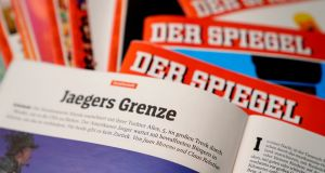 "The article ""Jaegers Grenze"" (Hunters' Border) co-written by  Claas Relotius in an issue of Der Spiegel. Photograph: Alexander Becher/EPA"
