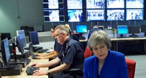 Britain's prime minister Theresa May visits the UK Border Force Command Centre at Terminal 5 in London Heathrow Airport on Wednesday.  Photograph: Niklas Halle'n/Reuters
