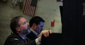 A trader on the NYSE watches as stocks fall following the Fed's rate announcement.