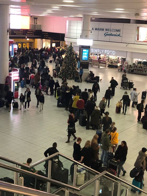 Queues of passengers in the check in area at Gatwick Airport on Thursday morning. Photograph: Thomas Hornall/PA
