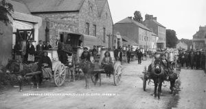 People drive carts outside Meadowvale Dairy Company in Charleville, c 1910. Photograph: National Library of Ireland/Flickr commons