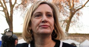 Amber Rudd speaks to the media outside the House of Commons. File photograph: Andy Rain/ EPA