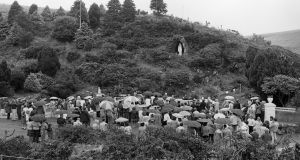 Crowds at the statue of the Virgin Mary  at Ballinspittle, Co Cork in 1985. Photograph: Jack McManus