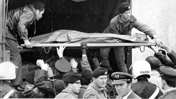 A victim of the Air India disaster is lifted onto an army truck at Cork Airport in 1985. Photograph: Jack McManus
