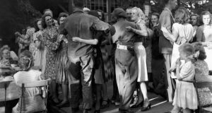 1945: British and American soldiers dancing with German girls in a Berlin street cafe only days after the fraternisation ban was lifted at the end of the second World War II. Photograph: Getty Images