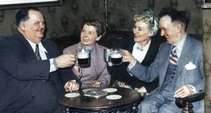 Oliver Hardy and Stan Laurel with their wives, Lucille and Ida, in Stan's sister's pub, in England, in 1952
