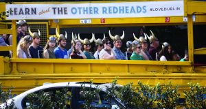Tourists enjoy a tour of Dublin with Viking Splash Tours. Photograph: Robert Alexander/ Getty Images
