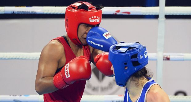 Sudaporn Seesondee (in red) and Kellie Anne Harrington  compete during their final fight at the  AIBA boxing championships in New Delhi, on November 24th, 2018. Photograph: Sajjad Hussain/AFP/Getty Images