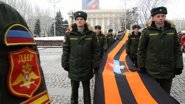 Servicemen during a celebration of Day of St George Ribbon in Donetsk's central square. Shakhtar had to leave the city in 2014. Photo: Valentin Sprinchak/Getty Images
