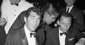 Dean Martin, Sammy Davis Jnr and Frank Sinatra at the Cocoanut Grove club, Hollywood, in 1961. Photograph: Express/Express/Getty Images