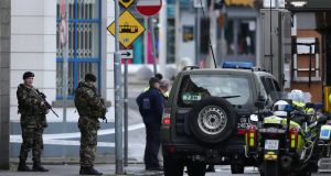 Soldiers and a bomb disposal unit vehicle outside the family court building at Phoenix House in the  Smithfield area of Dublin. Photograph:  Niall Carson/PA Wire
