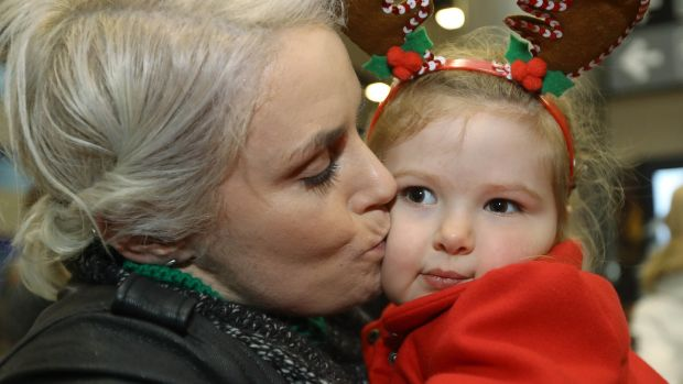 Fiona Costello from Galway, who arrived home from Toronto for Christmas on Friday, with her goddaughter Cerys Edwards. Photograph: Lorraine O'Sullivan/ The Irish Times