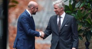 Belgium's former prime minister Charles Michel leaves a meeting with King Philippe at the Royal Palace in Brussels on Friday. Photograph: Francois Lenoir/Reuters