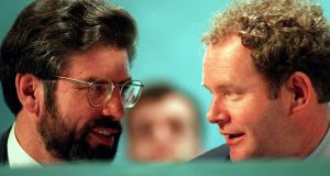 Sinn Féin president  Gerry Adams, speaking to vice-president Martin McGuinness, at the party's Ard Fheis. Photograph: Eric Luke