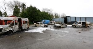 Burnt out vans and cars at  the house which was the scene of the  eviction in Strokestown. Photograph: Brian Farrell