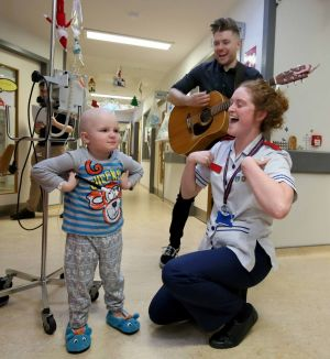 WARD WALK: Johnny O'Brien from The 2 Johnnies visits four-year-old Deivida Daseta during the Celebrity Ward Walk at Our Lady's Children's Hospital, Crumlin. Photograph: Mark Stedman