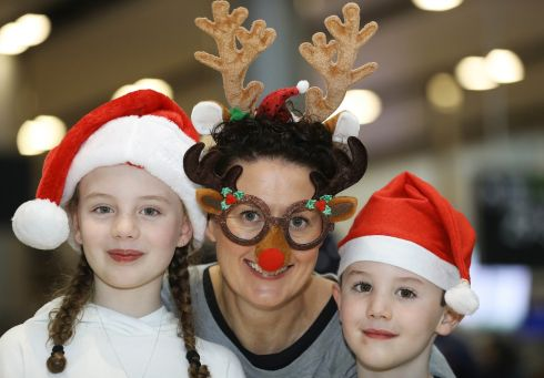 CHRISTMAS HOMECOMING: Aideen Scally from Co Kildare with her niece and nephew, Amy and Adam Scally, who are home from Boston, US, for Christmas. Photograph: Lorraine O'Sullivan/The Irish Times
