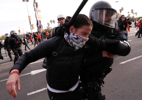 BARCELONA PROTEST: A police officer detains a demonstrator during a protest against a meeting of Spain's cabinet in Barcelona. Photograph: Susana Vera/Reuters