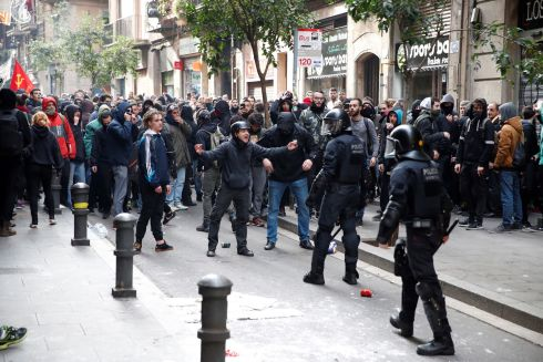 BARCELONA PROTEST: Catalan independence supporters confront police during a protest near where the Spanish cabinet was meeting in Barcelona. Photograph: Alberto Estevez/EPA